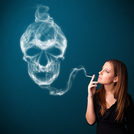 Pretty young woman smoking dangerous cigarette with toxic skull smoke Stock Photo - 21297554