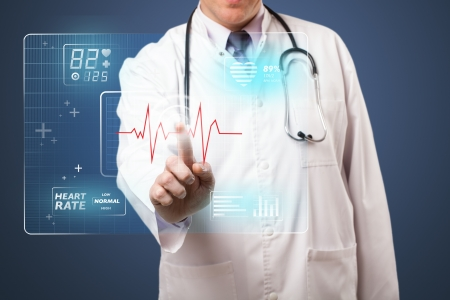 touch screen interface: Middle aged doctor standing and pressing modern medical type of button Stock Photo
