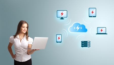 Beautiful young woman holding a laptop and presenting cloud computing network Stock Photo - 21298061