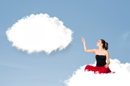 wishful: Pretty young girl sitting on cloud and thinking of abstract speech bubble with copy space Stock Photo