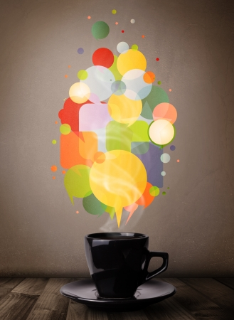 Tea cup with colorful speech bubbles, close up Stock Photo - 21250859