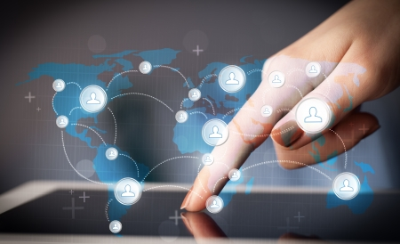 Finger pointing on tablet pc, social network concept photo