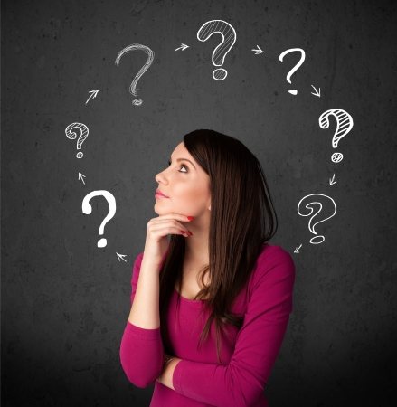 indecisive: Thoughtful young woman with drawn question marks circulating around her head