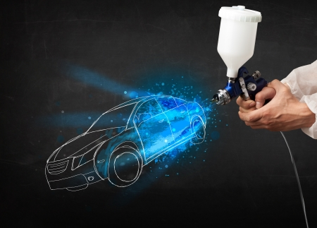 auto garage: Worker with airbrush gun painting hand drawn white car lines Stock Photo