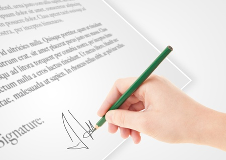 Hand writing personal signature on a legal paper  photo