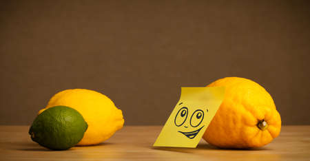 reacting: Lemon with sticky post-it note reacting to citrus fruits