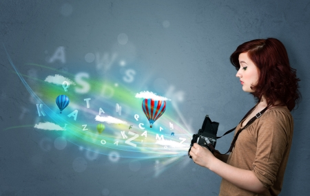 taking video: Cute photographer girl with camera and abstract imaginary Stock Photo