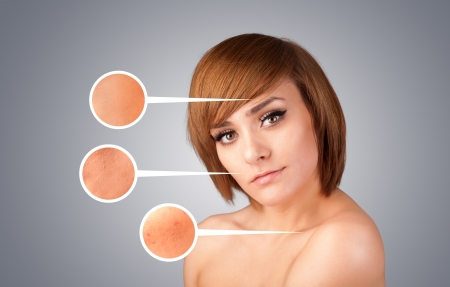Beautiful young girl with facial care arrow signs of damaged skin on gradient background Stock Photo - 21528086