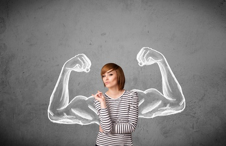 muscle woman: Pretty young woman with sketched strong and muscled arms