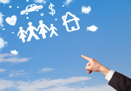 business savings: Hand pointing with finger at family and household clouds on blue sky