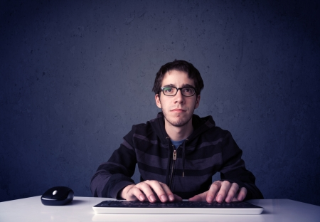 information technology law: Hacker working with keyboard and mouse on blue background