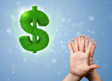 Happy cheerful smiley fingers looking at green leaf dollar sign photo