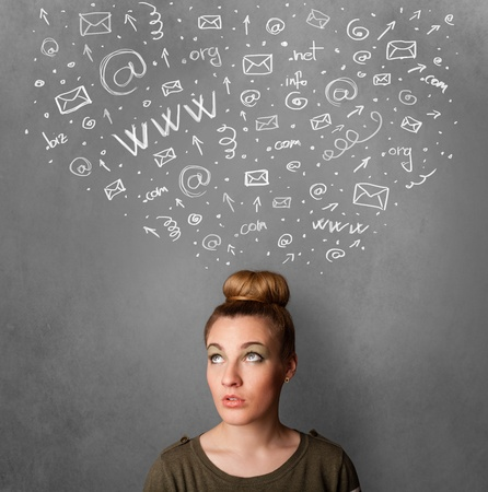 Pretty young woman gesturing with sketched social network icons above her head photo