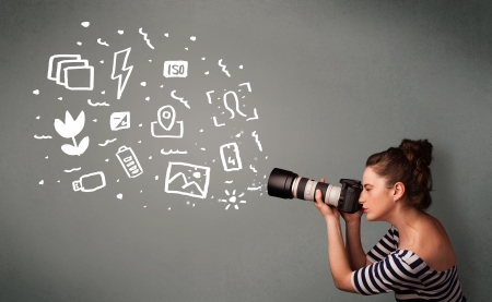Young photographer girl capturing white photography icons and symbols photo