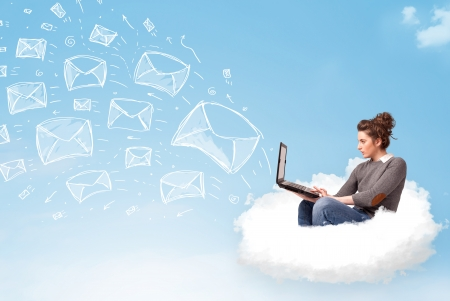 Pretty young woman sitting in cloud with laptop, sketched mails concept photo