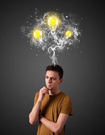 Handsome young man with smoke and lightbulbs above his head photo