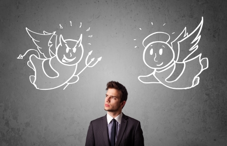 Young businessman standing between the angel and the devil drawings photo