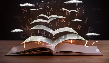 fantasy book: Pages and glowing letters flying out of a book on wooden deck Stock Photo