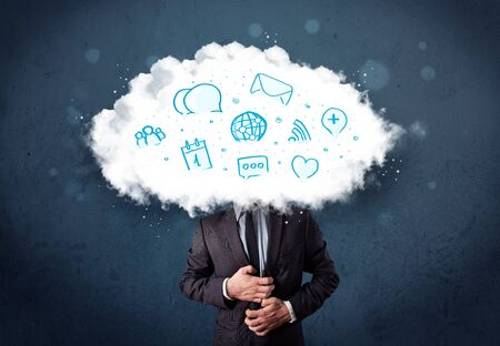 Man in suit with cloud head and blue icons on grungy background photo