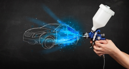 spray: Worker with airbrush gun painting hand drawn white car lines Stock Photo