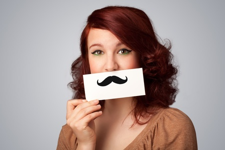 Happy cute girl holding paper with mustache drawing on gradient background Stock Photo - 21891765