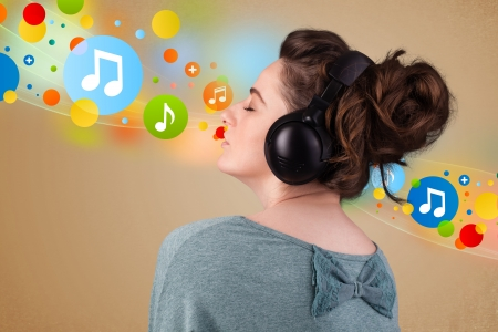 Pretty young woman with headphones listening to music, bubbles concept Stock Photo - 21891838