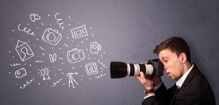 Attractive young photographer shooting photography icons photo