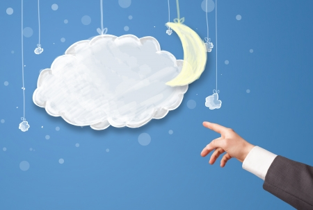 Hand pointing at cartoon night clouds with moon hanging down photo