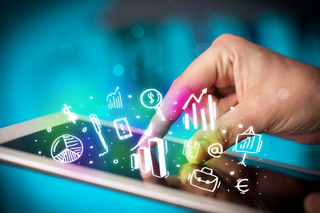 portable information device: Finger pointing on tablet pc, charts concept