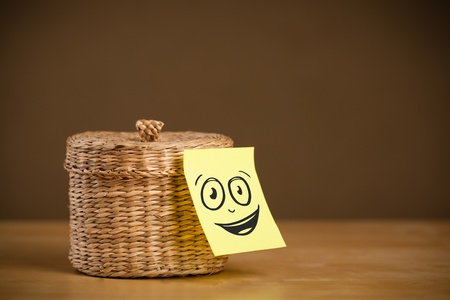 case sheet: Drawn smiley face on a post-it note sticked on a jewelry box