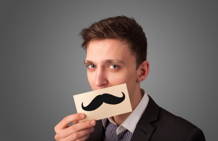 Happy businessman holding funny mustache card on his mouth with gradient background photo