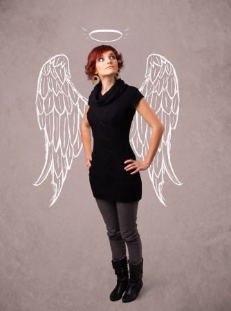 Cute girl with angel illustrated wings on grungy background Stock Photo - 22094247