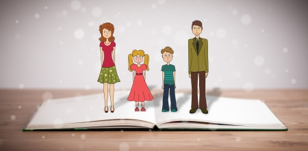 Drawing of a happy family on opened book. The symbol of unity and happiness photo