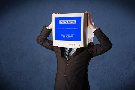 fatal: Person with a monitor head and fatal error blue screen on the display Stock Photo