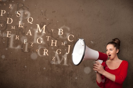 Young girl shouting into megaphone and abstract text come out Stock Photo - 22094276
