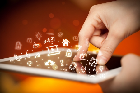 Hand touching tablet pc, social media concept photo