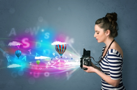Cute photographer girl with camera and abstract imaginary photo
