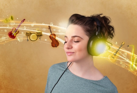 Pretty young woman with headphones listening to music, instruments concept photo