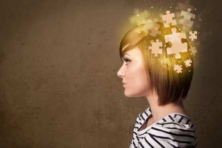 brain work: Young person thinking with glowing puzzle mind on grungy background