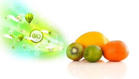 Colorful juicy fruits with green eco signs and icons on white background Stock Photo - 22220660
