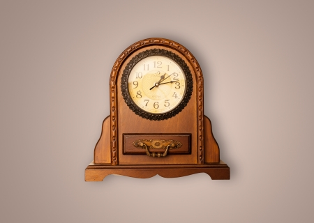 Vintage old clock with showing preicse time on the wall photo