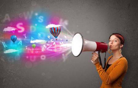 Cute girl shouting into megaphone and abstract text and balloons come out Stock Photo - 22220867