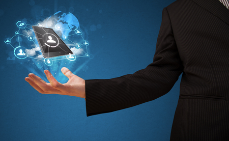 show business: Businessman presenting cloud technology in his palm Stock Photo