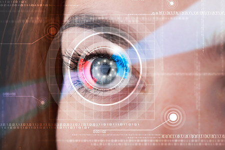 vision concept: Modern cyber woman with technolgy eye looking Stock Photo