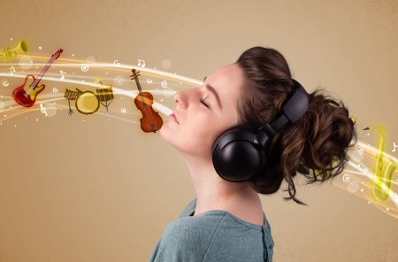 Pretty young woman listening to music, instruments concept photo