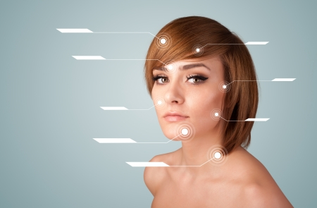 Young sexy girl with facial treatment modern arrows on gradient background photo