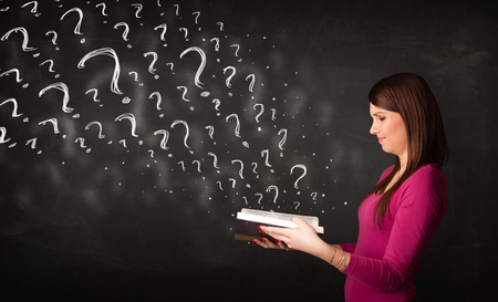 Confused woman reading a book with question marks coming out from it Stock Photo - 22521158
