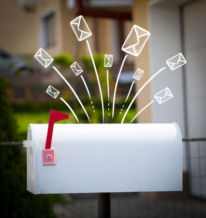 Hand drawn letters and envelopes comming out of a mailbox photo