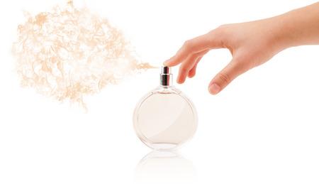 photomanipulation: close up of woman hands spraying perfume