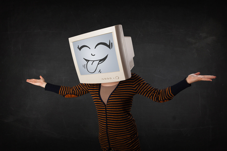 crt: Young girl wearing a monitor with a funny face gesture Stock Photo